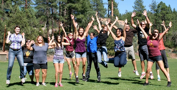 Students jump for joy at an NLASA retreat
