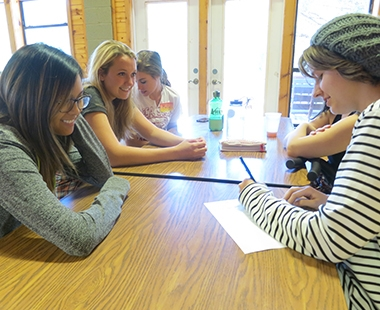 Stacia and other NLA students work together at the retreat