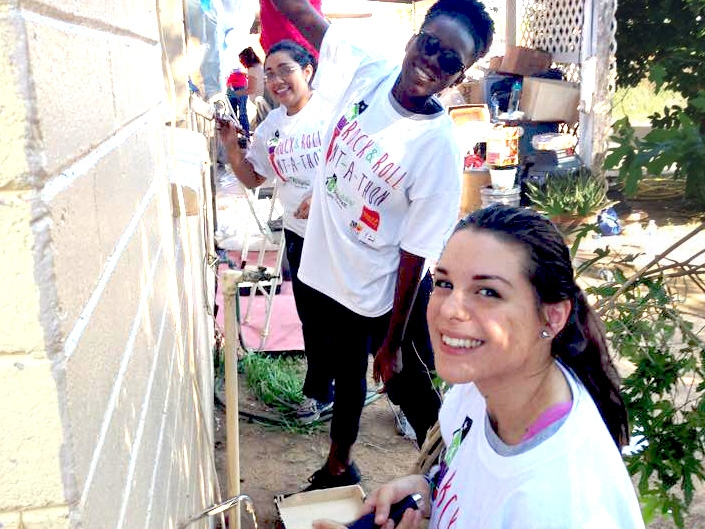 Public Allies work on a house for a Service Project